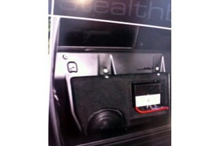 Jl audio stealth box with Jl amplifier behind the seat of a Toyota truck at Sounds Good To Me in Tempe Arizona